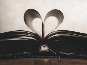 a book with paper shaped like a heart (Positive quotes that I loved)